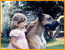 The trainer as a child, and her dog Brutus